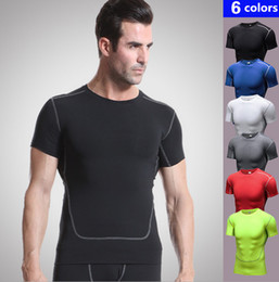 Quick Dry Shirts For Men Canada - Men fitness traning sport round collar hygroscopic skin-friendly high elastic sweat releasing quick-dry pure color PRO shirt for all year