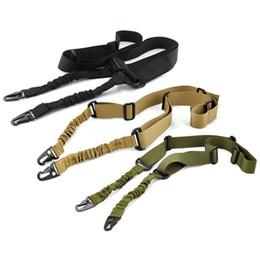 Venta al por mayor de Nylon multifunción Ajustable de dos puntos Tactical Rifle Sling Caza Correa de pistola Al aire libre Airsoft Mount Bungee System Kit Cinturón