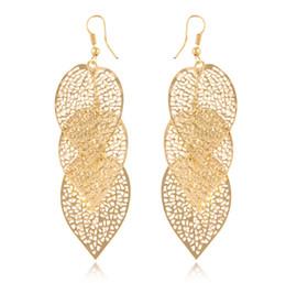 $enCountryForm.capitalKeyWord NZ - New fashion Jewelry Women Leaves Drop Earrings Gold&silver Hollow leaf metal Dangle & Chandelier Earrings For ladies Free shipping