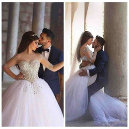Chinese  2019 Luxury Major Beading Wedding Dresses Sheer Illusion Half Sleeves Basque Waist Ball Gown Glitter Bridal Gown Lace Up Back manufacturers