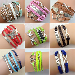 China Handmade Infinity Bracelets for Women 20 Designs Antique Cross Anchor Love Peach Heart Owl Bird Charm Leather bangles suppliers