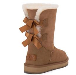 a4f8ce2e8 Invierno nuevas botas de piel de nieve caliente de piel de oveja en el tubo  de cuero cómodo botas femeninas dulces ronda pajarita de las señoras