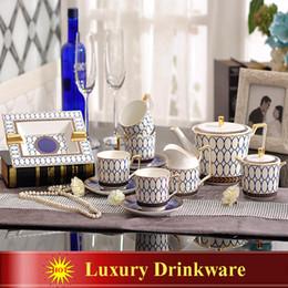 $enCountryForm.capitalKeyWord Canada - Porcelain coffee set bone china blue round design outline in gold 12pcs European tea set coffee pot coffee jug cup saucer set