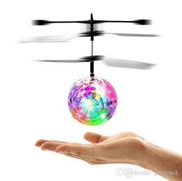 China Flying RC Ball Aircraft Helicopter Led Flashing Light Up Toy Induction Toy Electric Toy Drone For Kids Children c044 supplier light helicopters suppliers