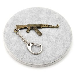$enCountryForm.capitalKeyWord Canada - Counter Strike Guns Keychain Trinket AK47 Key Chain For Men Vintage Silver Key Ring Holder Jewelry Souvenirs Gift Men Llaveros