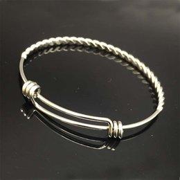 Braccialetto di modo della Cina 10pcs / lot, braccialetto del braccialetto del filo di torsione, braccialetto su ordinazione di fascino, braccialetti torti registrabili dell'acciaio inossidabile in Offerta