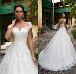 Robe De Corsage En Dentelle Pas Cher-2018 A-Line Robes de mariée en dentelle Illusion Bodice Lace-up Jewel Court Train Vintage Garden Boho Mariage Party Robes de mariée