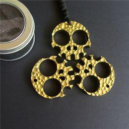 Apribottiglie in lega di titanio scheletro dorato che timbra la tasca esterna di sopravvivenza del dito del pugnale che disegna il multiutensile dell'utensile