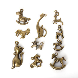 $enCountryForm.capitalKeyWord Canada - Free shipping Wholesale 73pcs lot Mixed Tibetan Zinc Alloy Wooden Horse Charms Antique Bronze Plated Pendants For DIY Jewelry Findings jewe