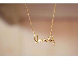 9e7be167044f 2016 Nueva Perla Colgante de Cristal Collares AMOR Moderno Encantador  Cadena de Oro Para Mujeres Niñas Envío gratis
