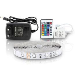 Vente en gros 5M 300Leds Non-imperméable à l'eau RGB a mené la lumière de bande 3528 DC12V 60Leds / M éclairage flexible Ficelle de ruban de ruban Lampe de décoration à la maison