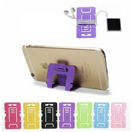 Venta al por mayor de De Buena Calidad El teléfono plegable plástico portátil de la tarjeta monta el tenedor del soporte de la tableta del teléfono celular para la PC de la tabla del teléfono 500pcs