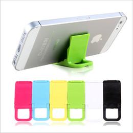 $enCountryForm.capitalKeyWord Canada - wholesale Candy Color Cell Phone Holder Bracket Mini Plastic Folding Dual Lazy Support Mobile Phone Mounts Universal Bracket