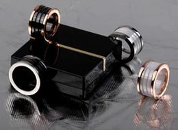 Опт Керамическое кольцо черный / белый керамические кольца завитка, желтое золото / розовое золото / серебро металлические цвета титана из нержавеющей стали женщины/мужчины ювелирные изделия - - - размер