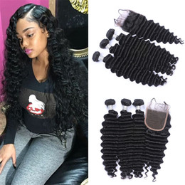 34 inches hair Australia - Brazilian Deep Wave Virgin Hair 3 Bundles With Lace Closure 4Pcs Lot Curly Human Hair Weaves With 4*4 Free Part Top Closure