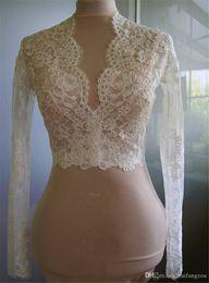 China Cheap Bridal Wraps Modest Alencon Lace Crystals V Neck Sheath Wedding Bridal Bolero For Wedding Dresses Long Sleeve Lace Applique Jacket supplier cheap lace wedding dress boleros suppliers