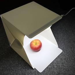 Mini Fotografia Fotografia da studio Shooting Tent Light Softbox e 2 Sfondi per la fotografia Scatola perfetta per girare gioielli Giocattoli Elettronica Foods in Offerta