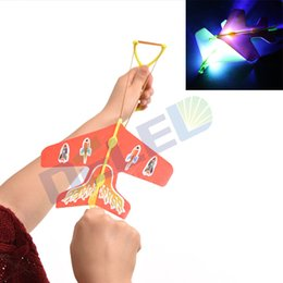 Wholesale Toys Helicopter NZ - Wholesale- 1pcs Stretch Flash Arrows Aircraft Catapult Flying Toys Helicopter Led Light Kids Light UP Toys Color For Random