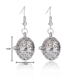$enCountryForm.capitalKeyWord UK - Fashion Oval Pearl Cage Pendant Earrings Hollow Four Leaf Clover Pattern Locket Dangle Earrings With Oyster Pearl Women Jewelry