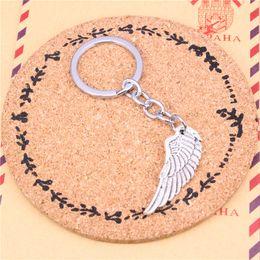 $enCountryForm.capitalKeyWord Canada - New Fashion Car Keychain Silver Color Metal Key Chains Accessory, angel wings Key Rings
