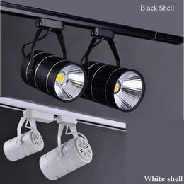 Light Warm Clothes NZ - Wholesale CREE cob led track lights spotlights 9W 12W clothing store mall lighting warm cold white + CE UL SAA