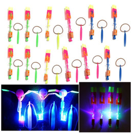Toy Flying Helicopters NZ - 20Pcs Lot Amazing LED Light Arrow Rocket Helicopter Rotating Flying Toy Fun Night Flashing Fly Arrow Kids Outdoor Flashing Toy