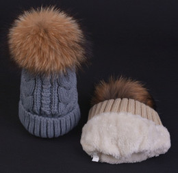 6f2483d3b5a Quality Cable Knitted Yarn Thick Beanies Racoon Dog Fur Ball For Adults  Mens Womens Winter Hip Hop Pom Rib Hats Head Ears Warmer Snow Cap