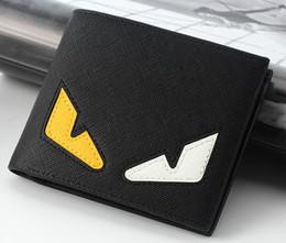 Alta qualità Nuovo mens moda piccolo mostro designer portafogli maschio personalità in stile breve gioventù portafogli borse no39 in Offerta