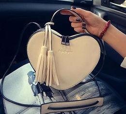 Heart Shaped Handbags Wholesale Australia - Handbags For Women Heart Shaped Tassel Cross Body Messenger Bag Personality Luxury Shoulder Bag Free Shipping Hot Sale 20 PCS YYA376