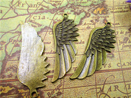 wholesale bronze fairies Australia - 15pcs--Angel Wings Charms, Antique bronze tone Angels Fairy Feathers Wing charm pendants 59x22mm