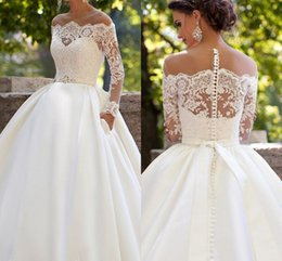 Applique À Ongles En Dentelle De Mariage Pas Cher-Plus Size 2017 Beach Wedding Ddresses A-ligne Robes de Mariage Dentelle Decals Nail Bead Hollow Bow Mariage Satin Long Manches Button Bride Weddin