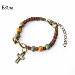 Chinese  BoYuTe 5Pcs Vintage Hand-knitted Adjustable Rope Chain Cross Bracelet Ceramic Bead Charm Bracelet Womem Fashion Jewelry manufacturers