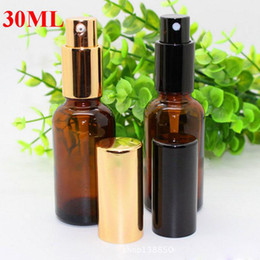 $enCountryForm.capitalKeyWord Canada - Hot sale 30ml Amber Glass Spray Bottles Wholesale Essential Oils Glass Bottle With Black or Gold Cap For Skin Care Make up