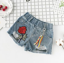 kids jeans designs Canada - New Summer Child Girls Denim Shorts Baby Kids Children Rose Flower Embroidery Hole Design Jeans Shorts 3041