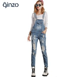 $enCountryForm.capitalKeyWord NZ - Wholesale- Women's casual loose plus size overalls Lady's large size hole ripped jeans Female jumpsuits Denim long trousers Free shipping
