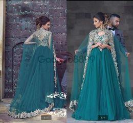 2017 New Design Hunter A line Lace Appliques Evening Dresses with Cape formal  Beaded Elegant Modest Arabic Dubai Muslim Occasion Prom Gowns 26c053342e82