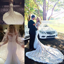 Dress Sleevs Canada - Chapel Train Lace Mermaid Wedding Dresses 2017 Modest Sheer Neck Long Sleevs Vintage Bohemian Country Bridal Gowns With Free Veil