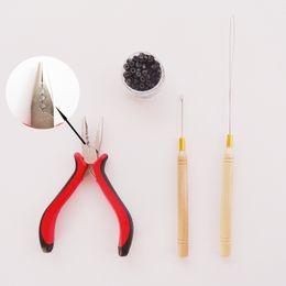 ¡CALIENTE! 1 botella / 200pcs Micro Links / Beads + 1pcs Aguja de tracción + 1pc 3 agujeros alicates Kit de herramientas de extensiones de cabello en venta