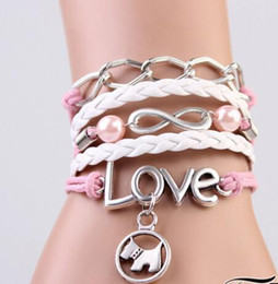 $enCountryForm.capitalKeyWord Canada - Love Pink Leather Knitting Dog Pendant Charm Bracelets Vintage Chain Infinity Knitted Bracelets Design fashion Antique Bracelets for women