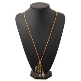 1ac0ec4ed5dd cuentas de cerámica collar étnico hecho a mano trenzado suéter cadena  original vintage largo colgantes decoración de la hoja collar de moda