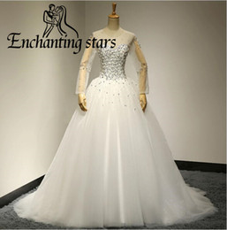 Manches Longues Blanches À Quinceanera Pas Cher-Illusion Long Sleeves Quinceanera Robes Cheap 2017 Strass Cristaux Open Back Ball Gown Robe de fête Vintage White Sweet 16 Prom Gowns