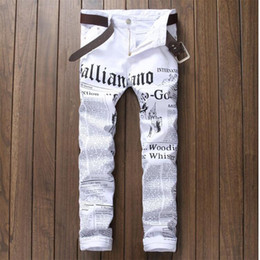 Wholesale male white jeans autumn flower print news cotton elastic jeans slim Pants Black male trousers for singer star nightclub
