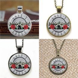Earring guns online shopping - 10pcs Guns and Roses Jewelry Glass Photo Necklace keyring bookmark cufflink earring bracelet