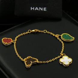 Großhandel Hohe qualität neue 18 karat vergoldet vier kleeblatt blume schmetterling frauen charme armband für geschenk