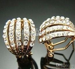 Dazzlingl Crystals 14k gold Earrings studs