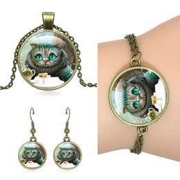Wholesale Pendant Sets NZ - Hot!5Set Unique Vintage Bronze Jewelry Set Cheshire Cat art Glass Dome Pendant Necklace Stud Earrings Bracelets Set For Women Jewelry