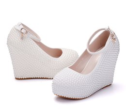 China Crystal Queen Woman Platform Wedges White Ivory Pearl Crystal Rhinestone Wedding Bridal Shoes High Heels Pumps Wedges 11.5cm supplier queen bridal wedding dresses suppliers