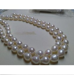Chinese  35 inch AAA 10-13mm genuine south sea white pearl necklace 14k manufacturers