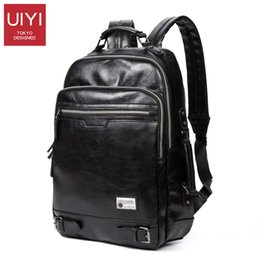 c04e6d4338 Wholesale- UIYI Men s New Black leather shoulder backpack PU soft leather Male  Backpack Leisure Men Zipper 14-inch Laptop Bags Multi-pocket