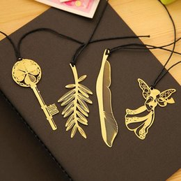 $enCountryForm.capitalKeyWord Canada - Gold-Plated Leaves Key Feather Angel Bookmark Paper Clip School Office Supply Escolar Papelaria Gift Stationery
